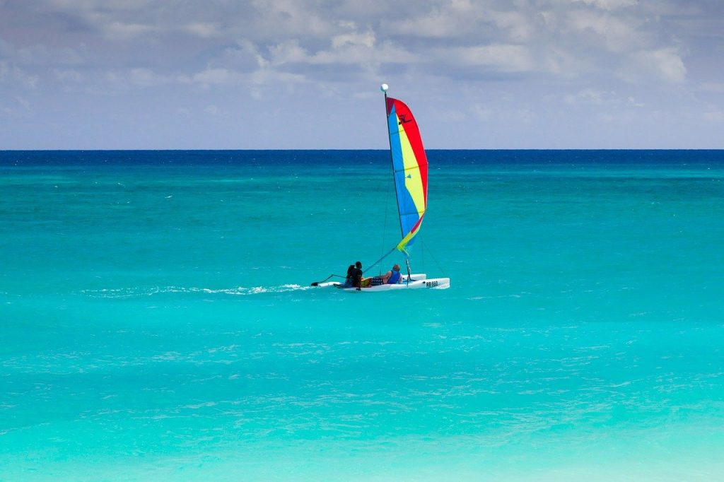 A group of people wind sailing on the open water in the US Virgin Islands enjoying their vacation,
