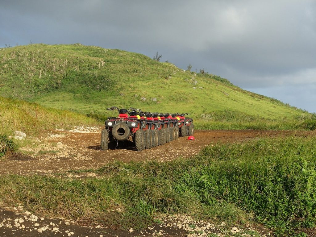 ATVs set up to explore the Saipan landscape for people who are on vacation.