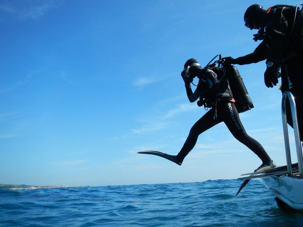 Scuba diver getting ready to jump in the water for a dive off the cost of the northern Mariana Islands.