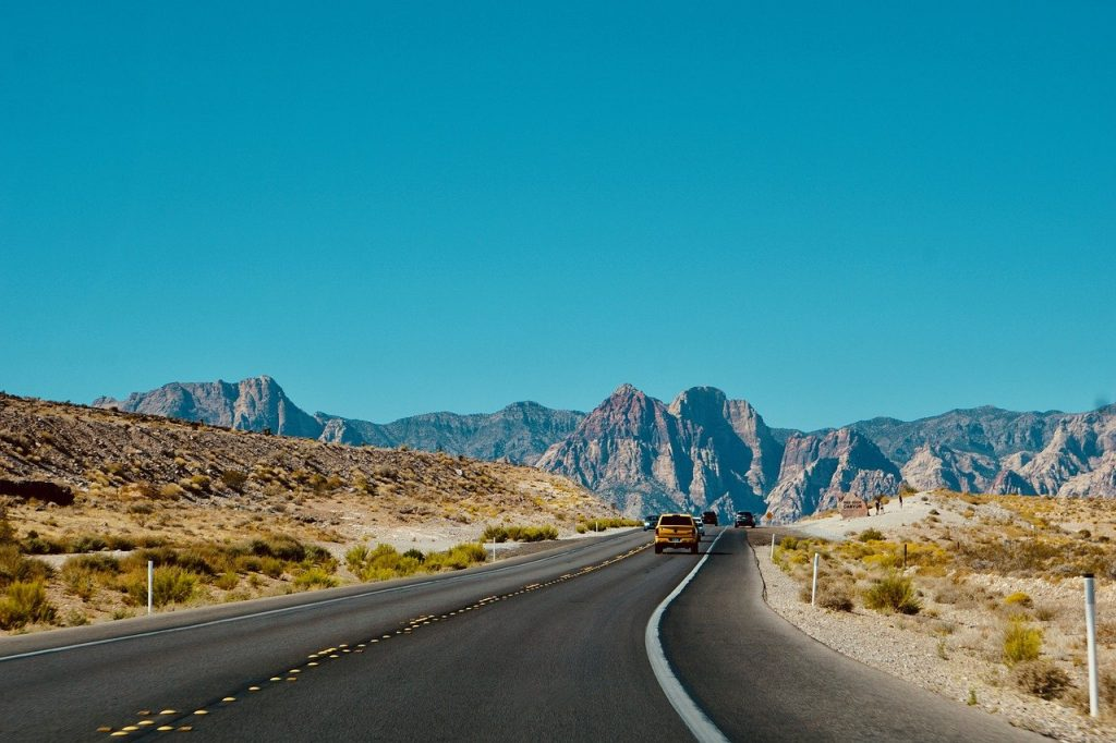 Open highway through Utah showing cars traveling up and down the road viewing the scenic landscape.