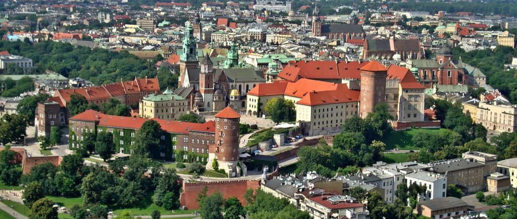 Karkow, Poland a large shot of the city taken from the air with red roofed buidlings.
