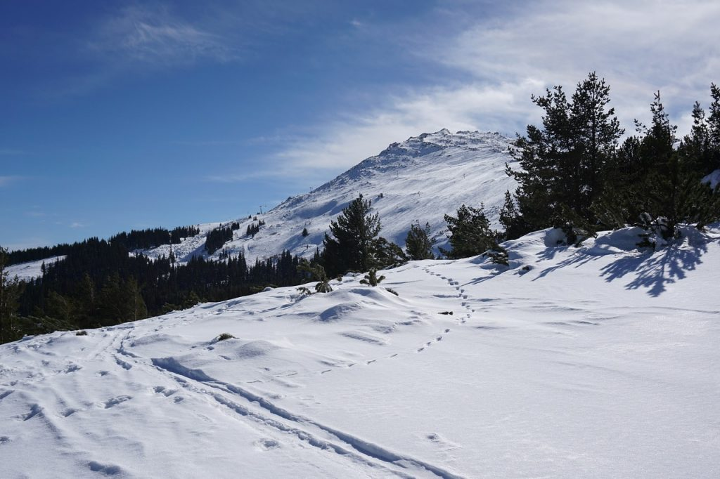 A snowy mountain top in Bulgaria a great place to go skiing in Europe on an inexpensive vacation.