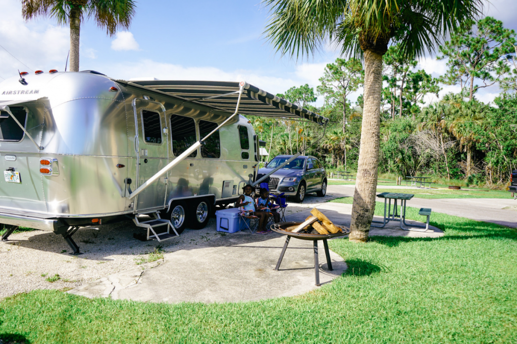 RV sitting in an RV park camping spot that was located and booked using the best RV travel app to find the location.